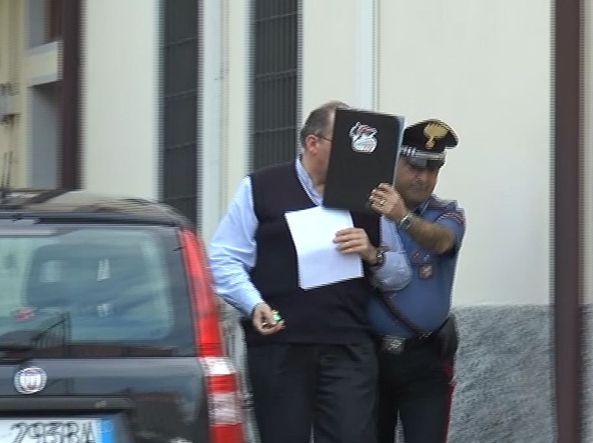 Don Angelo Blanchetti al momento dell'arresto